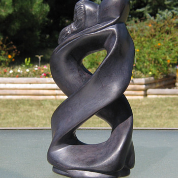 Man and woman figure 8 abstract  Ironwood?