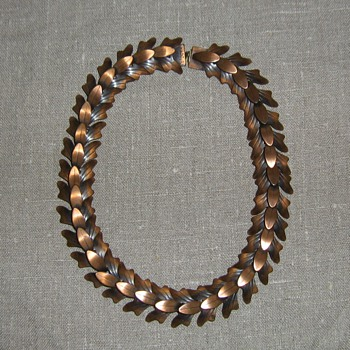 Rebajes articulated copper leaf necklace and leaf plaque pin
