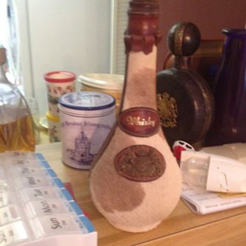 Grandmother's animal skin whiskey bottle