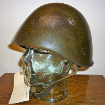 Italian Battle Damaged WW2 steel helmet.