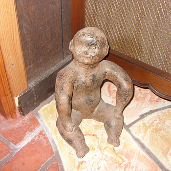 some kind of creepy doll - Art Pottery