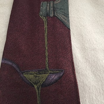 Another Fendi Necktie - Pouring liquid from one bottle to another, over a spoon?  What is that about?