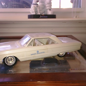'66 Plymouth Driver's Ed Fury & my Motorific cars...  The motorifics were battery powered..