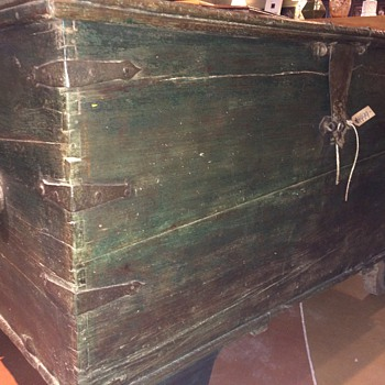 large trunk with wooden wheels