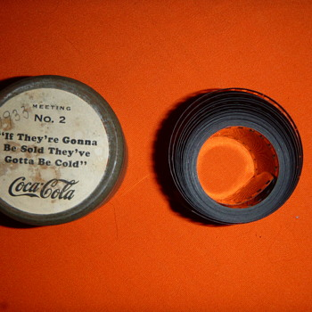 "Coca Cola Tin Box (diameter 2.25"" and 1.5"" tall) with 35mm film about 2 meters long) - Coca-Cola"