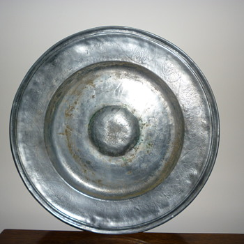 Large pewter platter. Date unknown - Kitchen