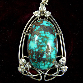 A Large Silver and Turquoise Pendant, designed by Archibald Knox for Liberty & Co.