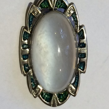 "Tiny sterling enamel and ""moonstone"" brooch, marked sterling."
