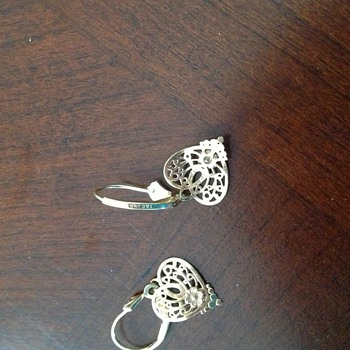 ? If anyone know about 14kt T and C Heart Earrings.  What is it?