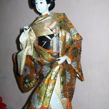 Geisha removing her outer Kimono - Dolls