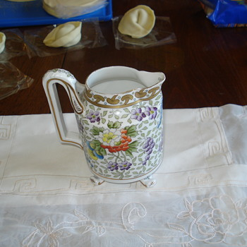 A rare Oscar and Edgar Gutherz milk jug