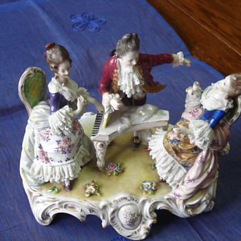 A figurine group Capodimonte mark  - Figurines