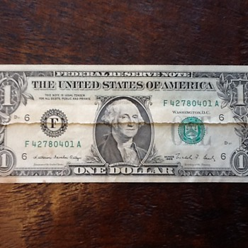 Dollar printed on paper splice?