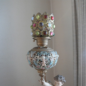 "Figural kerosene lamp, label: Love's Victory"". - Lamps"
