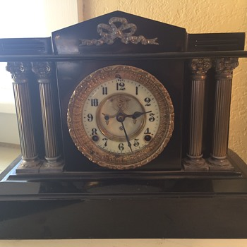 Completely functional old mantle chimming clock