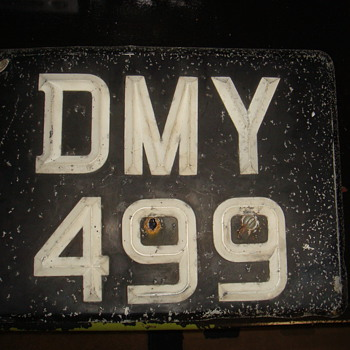 Looks like some kind of license plate. - Signs