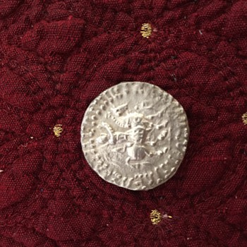 Help identifying this coin.  - World Coins