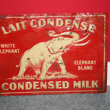 white elephant condensed milk tin sign