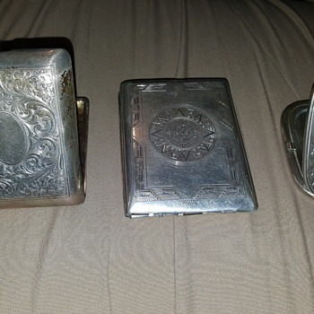 Vintage cigarette cases and silver unused make up compact.