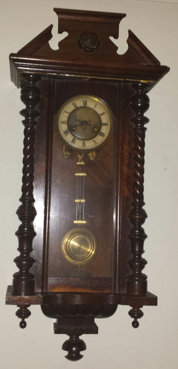 My favorite antique wall clock with pendulum.