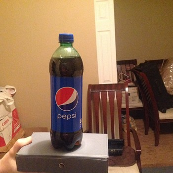 Pepsi in a ginger ale bottle