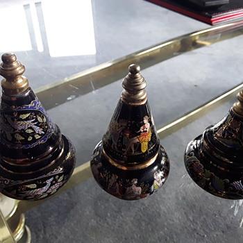 Three graduated perfume bottles