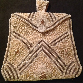 Small beaded bag with integral mirror and comb.