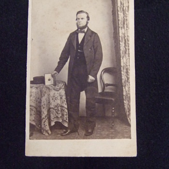 CDV of man with photo album showing image - Photographs
