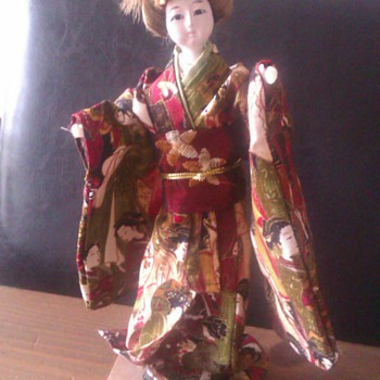 Tiny geisha doll