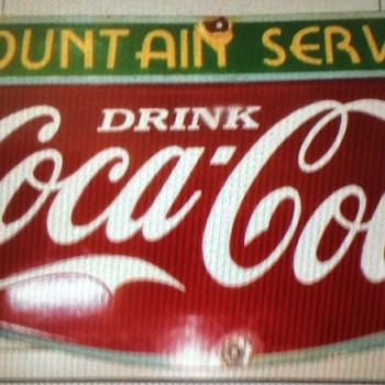 What year is this sign made ? - Coca-Cola