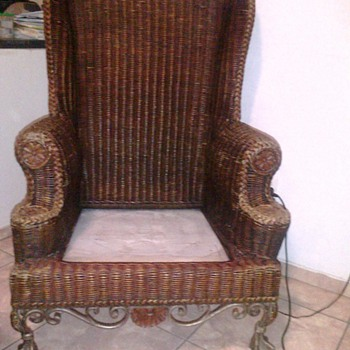 Beautiful Rattan Wicker Wingback chair with cast iron ball and claw feet