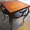 Very old steel table with 4 swing out seats