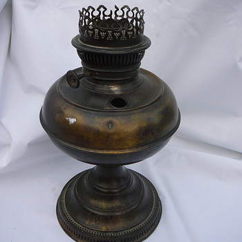 I need help to identify this great old brass oil lamp