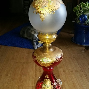 red and golden lamp with flowers