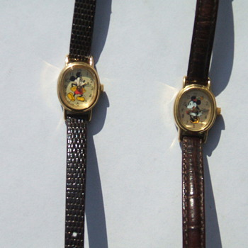 Small Oval Mickey and Minnie watches. Att. eye4beauty - Wristwatches