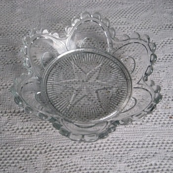 nut dish with star in the bottom and elaborate scallops