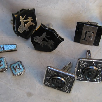 Mad men cufflinks: Romans, Shields, Chariots, Mosiacs....