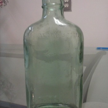 this aqua green flange lip liquor bottle