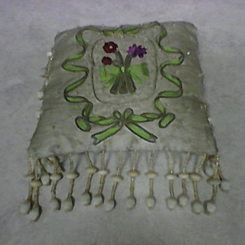 A SMALL VINTAGE BEADED PILLOW - Rugs and Textiles