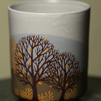 a simple, unmarked cup with a beautiful image and colors. - Pottery
