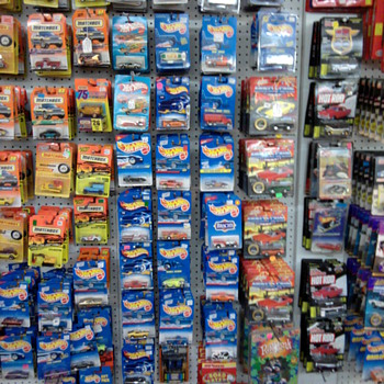 Unopened Hot Wheels and Matchbox cars on the card...