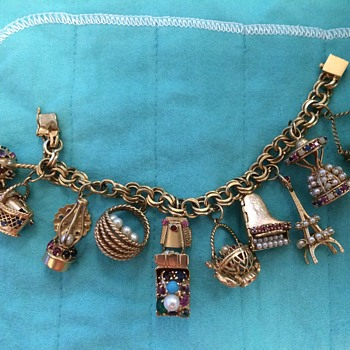 Articulated 14K gold charm bracelet with precious stones