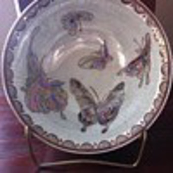 Gorgeous pearlized and gold with butterflies who is the asian artist????