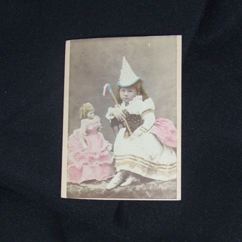 Beautifully tinted young girl and her large doll CDV