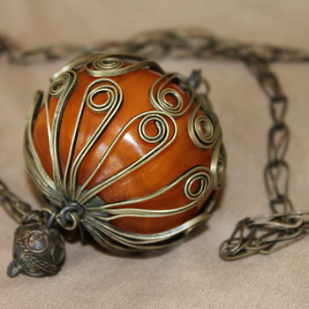 Massive Bakelite in an Odd Cage - Costume Jewelry