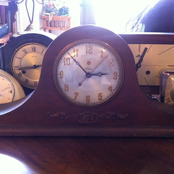 some clocks I have sitting in my living room  - Clocks