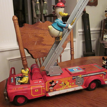 1950&#039;s Walt Disney Fire Engine with Pluto, Donald, and Mickey