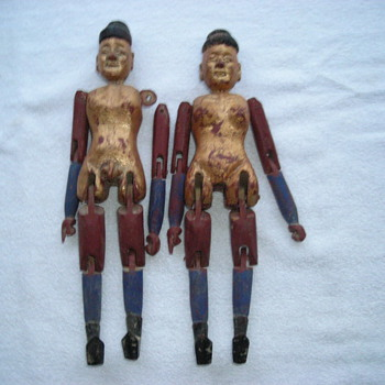 Asian wood folk dolls