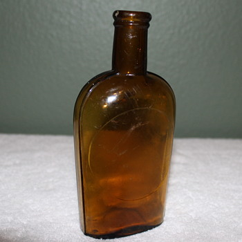 Pre Prohibition Handblowen 1/2 pint Strap Sided Cork Top Bottle - Bottles
