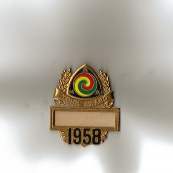 Vintage AMA pins and 'Tour Awards' from 1954, 1958 & 1959